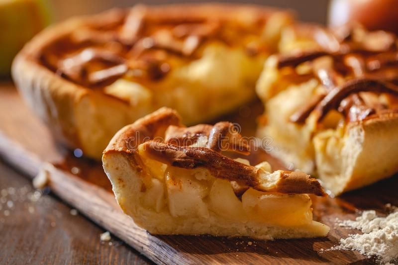 American cuisine. Homemade apple pie on wooden background. Classic autumn Thanksgiving dessert. Close up stock photo