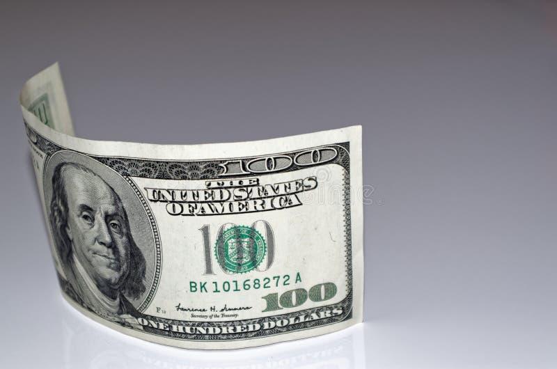 100 american dollar banknote on light grey background. Close up photo of 100 american dollar banknote on light grey background stock photography