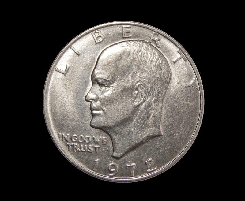 One US dollar coin on isolated black background. American dollar eisenhower lunar dollar on isolated black background royalty free stock image