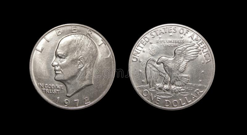 One US dollar coin on isolated black background. American dollar eisenhower lunar dollar on isolated black background royalty free stock photography