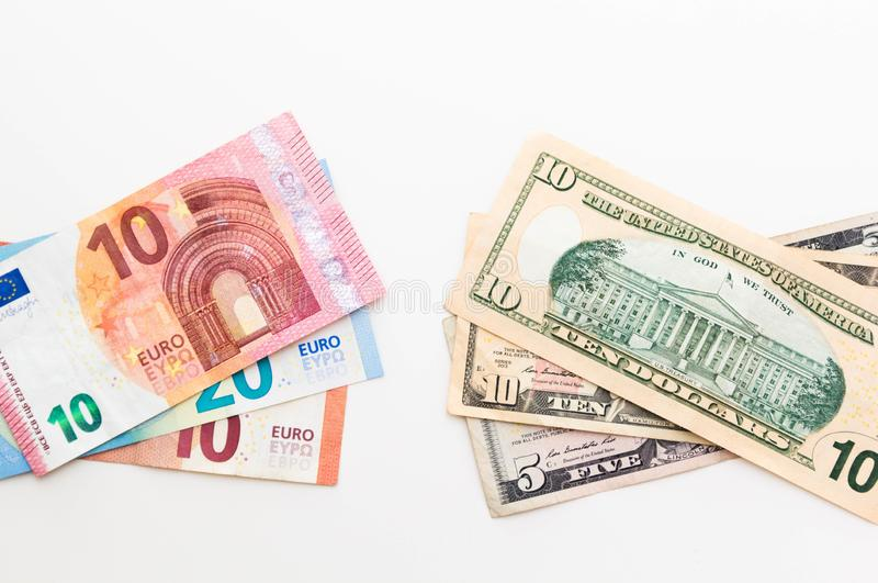 American Dollar and Euro Banknotes isolated on white background. Money savings concept royalty free stock photos