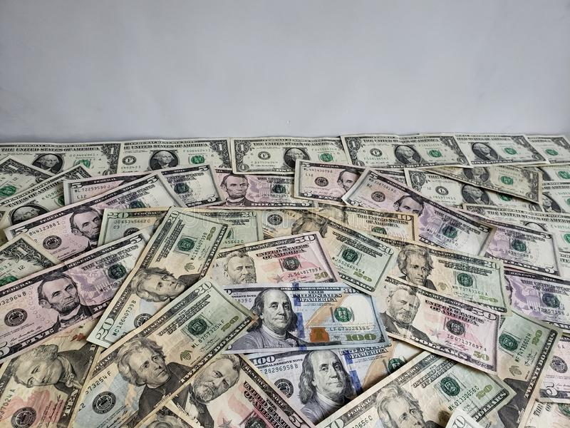 American dollars banknotes of different denominations, background and texture. Commerce, exchange, trade, trading, value, buy, sell, profit, price, rate stock image