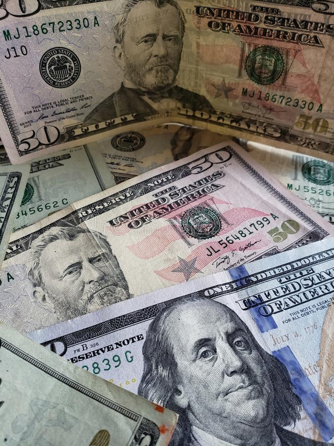 American dollars banknotes of different denominations, background and texture. Commerce, exchange, trade, trading, value, buy, sell, profit, price, rate stock photos