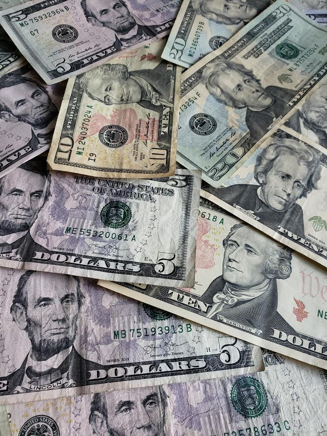 American dollars banknotes of different denominations, background and texture. Commerce, exchange, trade, trading, value, buy, sell, profit, price, rate royalty free stock image