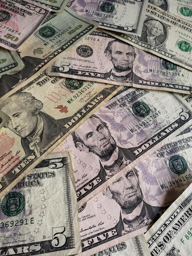 American dollars banknotes of different denominations, background and texture. Commerce, exchange, trade, trading, value, buy, sell, profit, price, rate royalty free stock photography