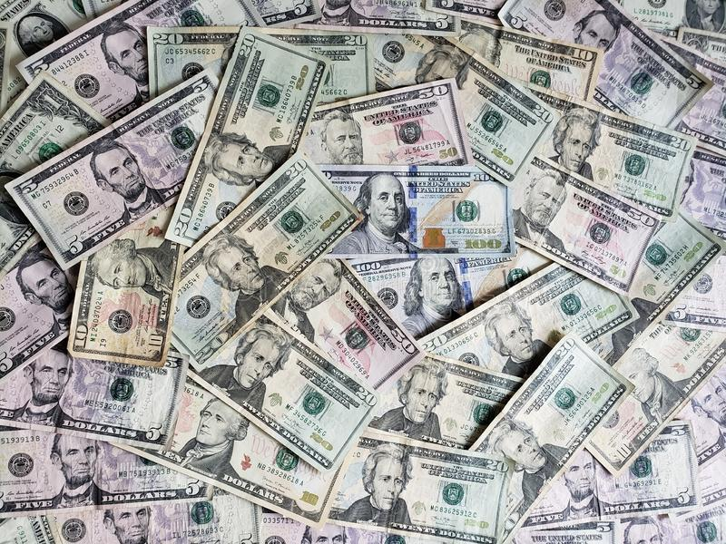 American dollars banknotes of different denominations, background and texture. Commerce, exchange, trade, trading, value, buy, sell, profit, price, rate royalty free stock photo