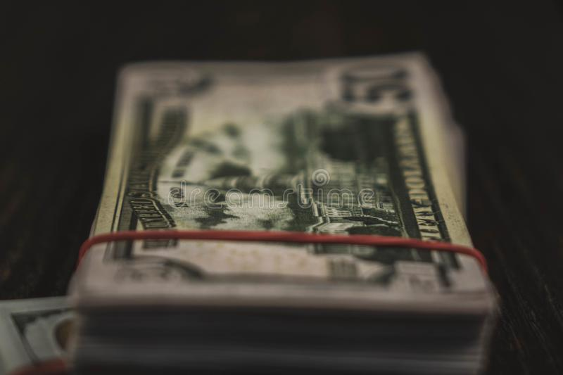 american Dollars banknotes isolated on black background stock photography