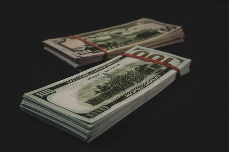 american Dollars banknotes isolated on black background stock images
