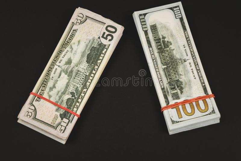 american Dollars banknotes isolated on black background stock photos