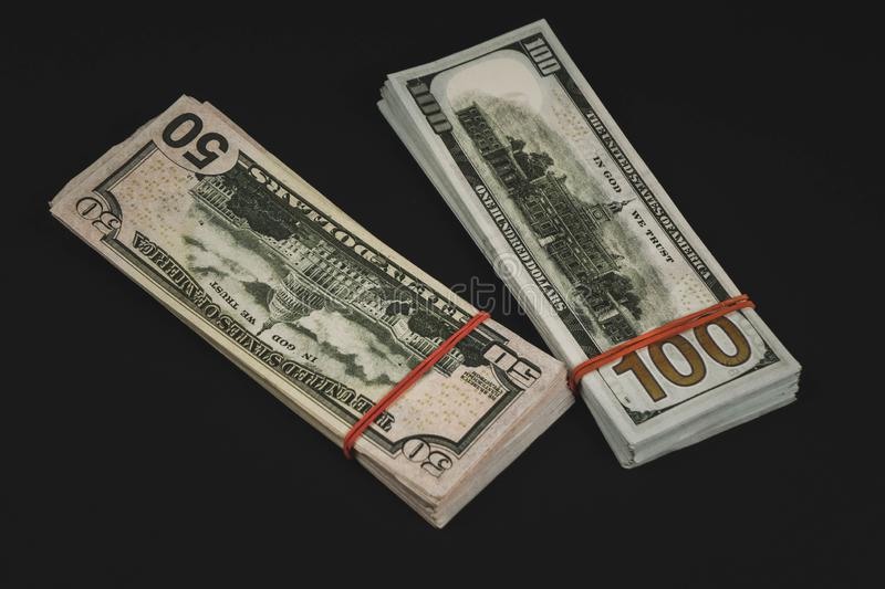 american Dollars banknotes isolated on black background stock photo
