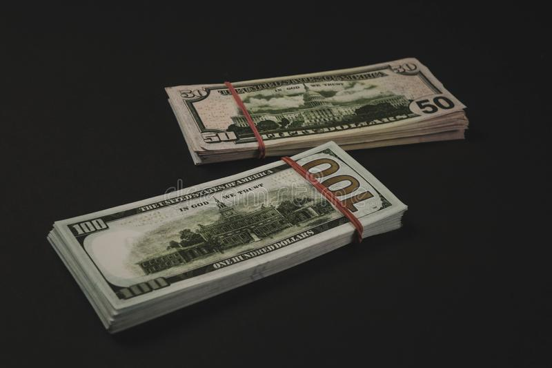 american Dollars banknotes isolated on black background stock image