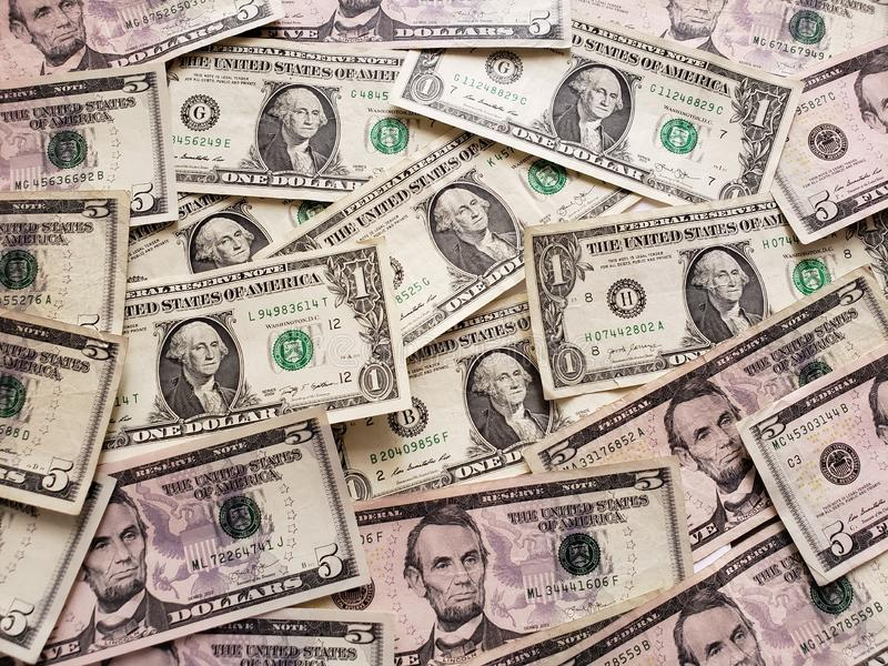 American dollars banknotes unorganized, background and texture. Usd, usa, commerce, exchange, trade, trading, value, buy, sell, profit, price, rate, cash stock photography