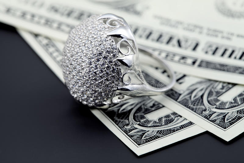 American dollars and jewelry diamond ring. American dollars. Bundle of bank notes and brilliant ring stock images
