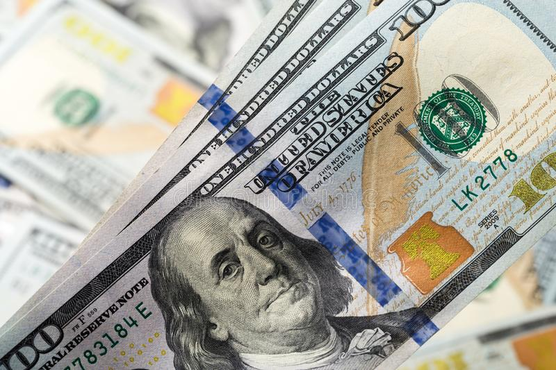 American dollars. A stack of hundred dollar bills. Close up stock photography