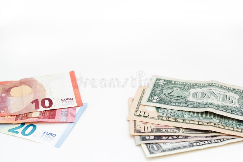 American euro and dollars banknotes for business design. Cash money various currency paper bills on white background.  stock photos