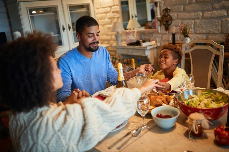 American Family Family dining at home celebrating christmas eve with traditional food and decoration royalty free stock photos