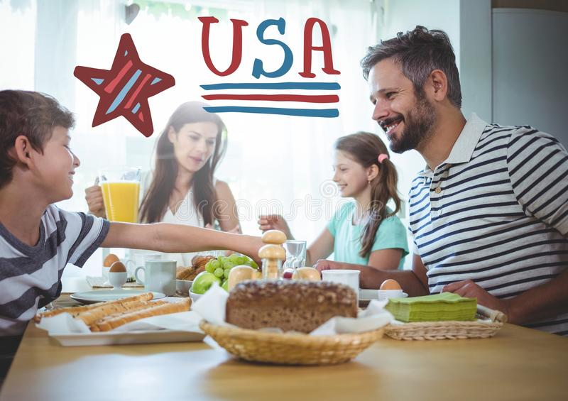 American family sitting around a table for 4th of July dinner stock image