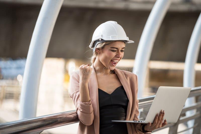 American female engineer celebrate in city stock photo
