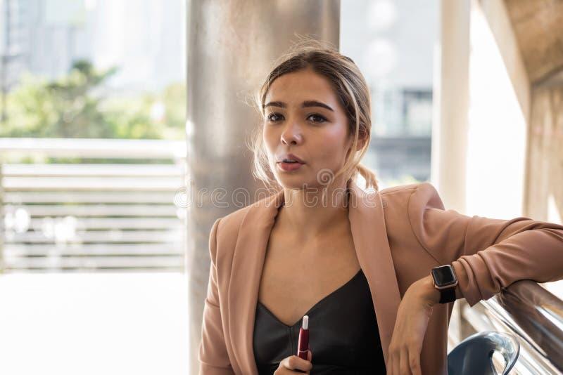American female worker smoke e-cigarette royalty free stock photo