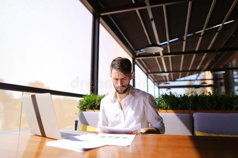 American financier working with laptop and diagram documents at royalty free stock photos