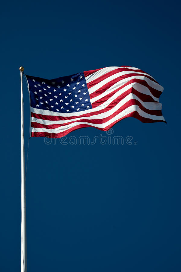 American Flag. On the blue sky stock image