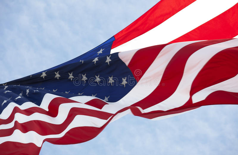 American flag. Photo of American flag waving in the wind stock photography
