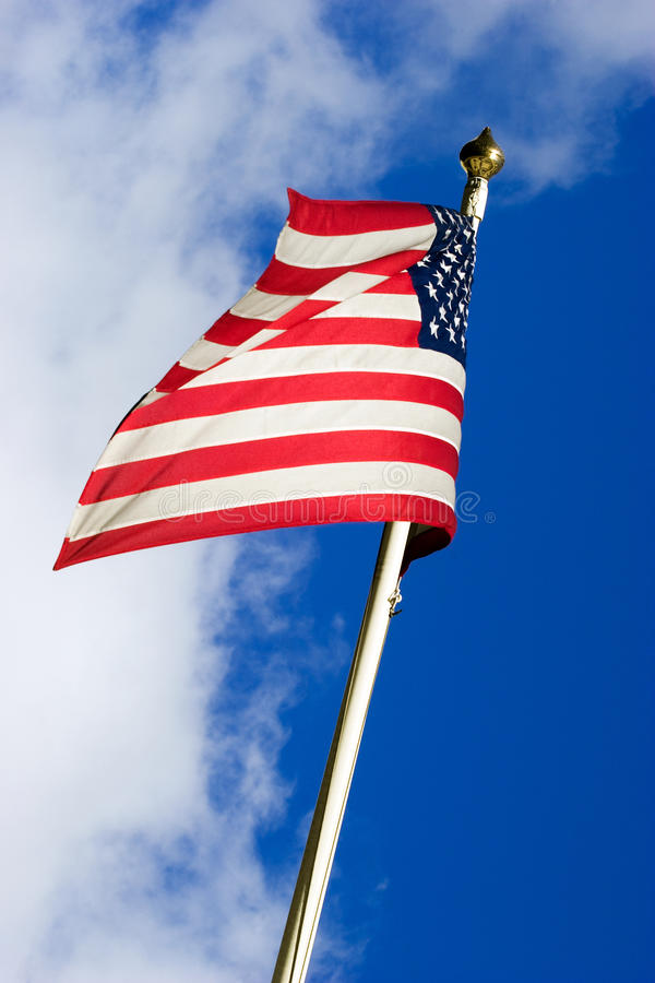 American flag. Flying in the wind. Clipping path included for easy background replace royalty free stock photo