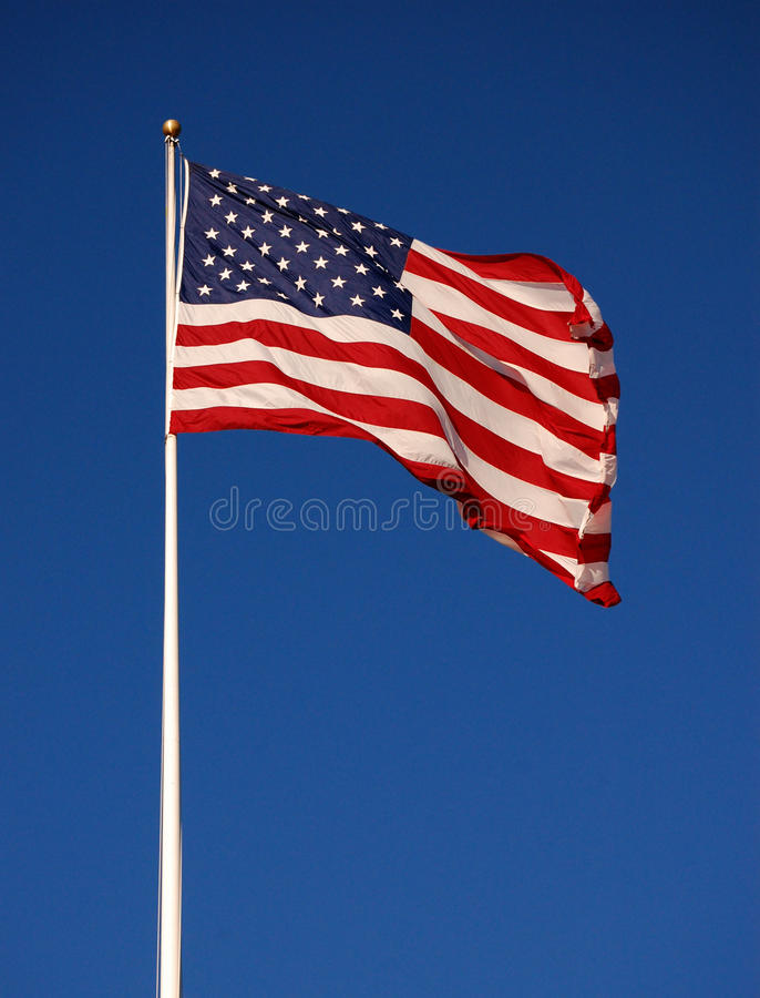 American flag. Flapping, with clear sky background, vertical stock photos