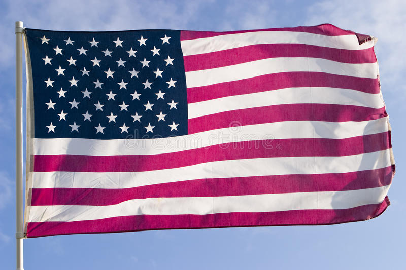 American Flag. The American flag, flying in a strong wind, is almost perfectly horizontal. Every stripe and every star is visible royalty free stock image