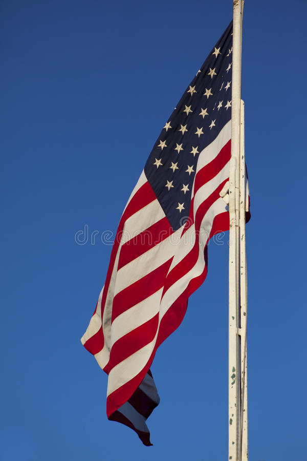 American Flag. Large American Flag On Blue Sky royalty free stock photography