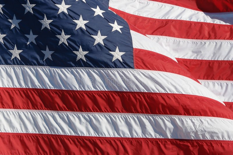 American flag. Inverted american flag moved by strong wind royalty free stock photos