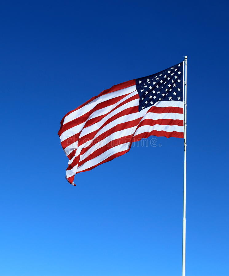 American Flag. On Blue sky royalty free stock photos