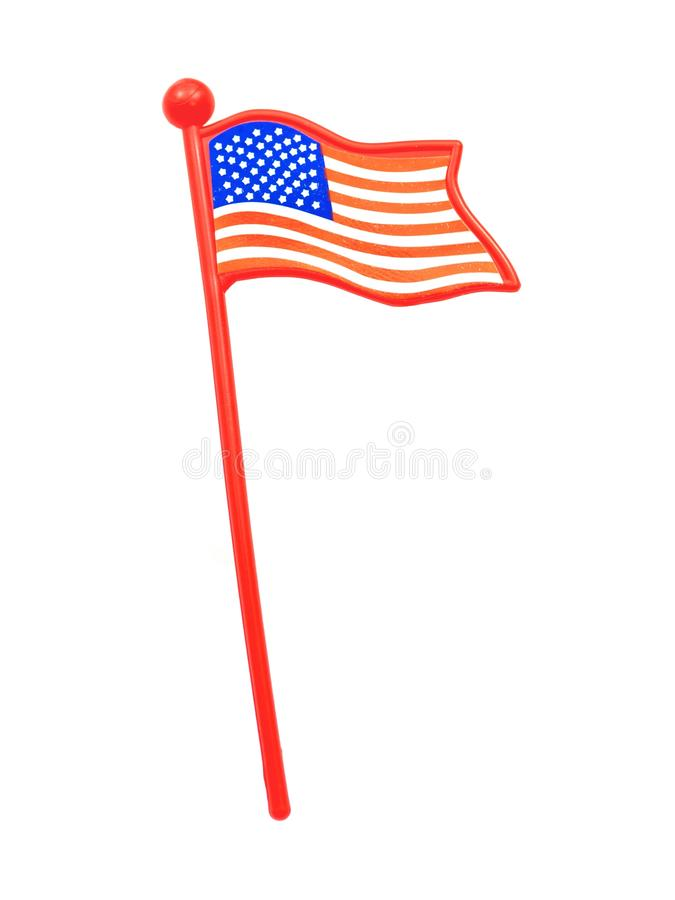 American Flag. A toy American flag isolated against a white background royalty free stock images