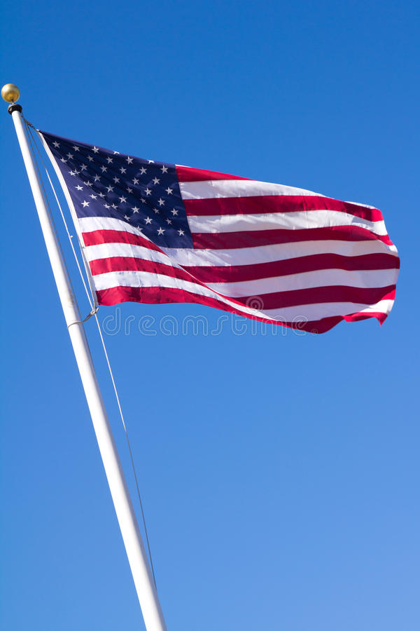 American flag. Photo of American flag waving in the wind royalty free stock photos