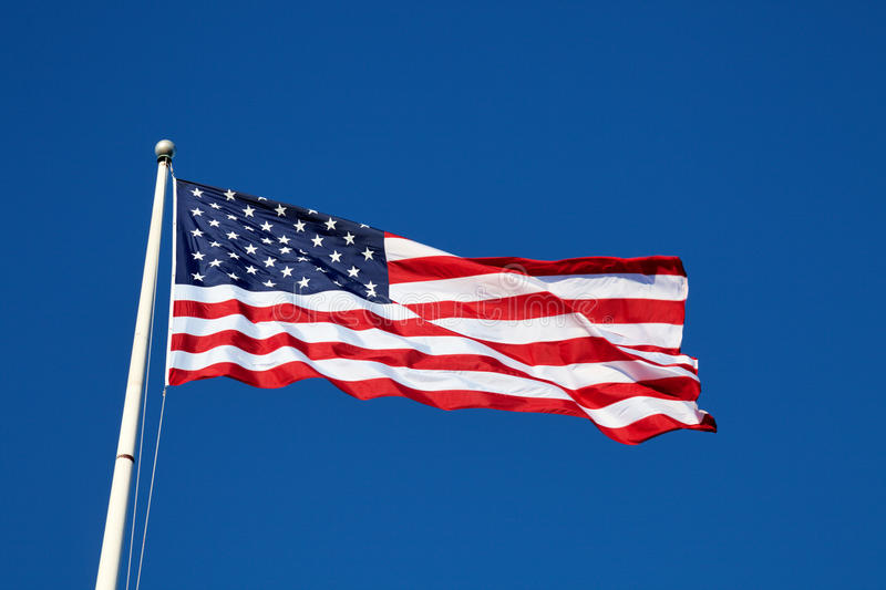 American flag. Against blue sky royalty free stock images