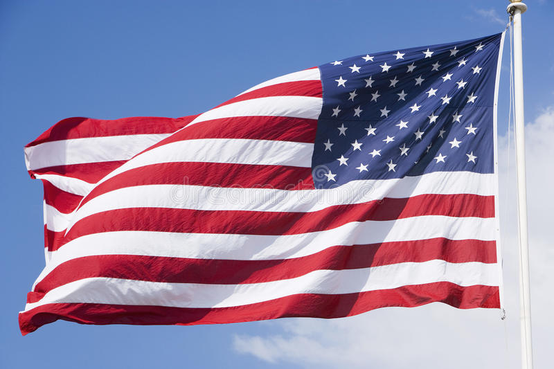 American Flag. With sky in the background stock photos
