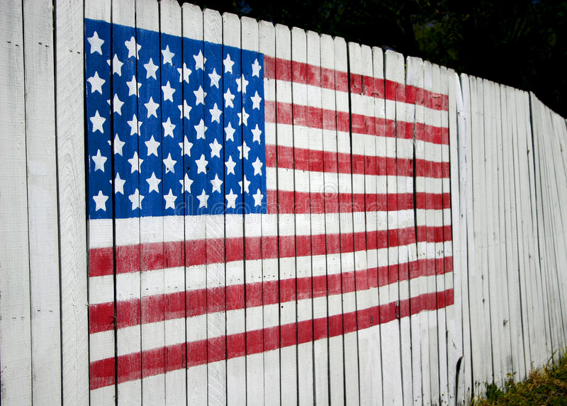 American Flag. On fence, denoting patriotism royalty free stock photography