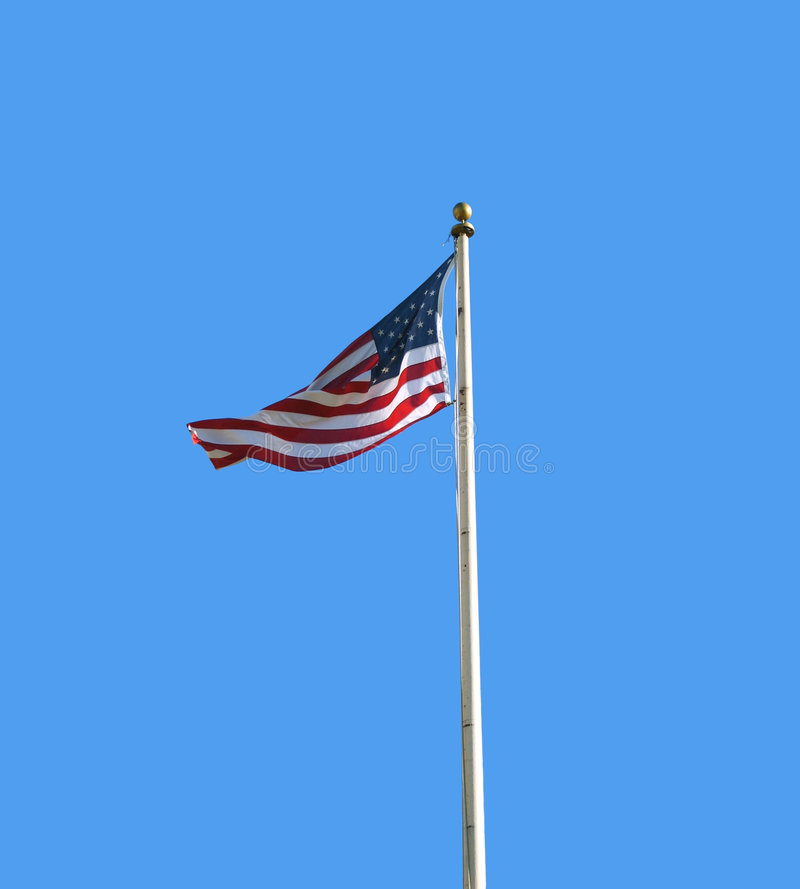 American Flag. Blowing in the wind on a flagpole royalty free stock photography