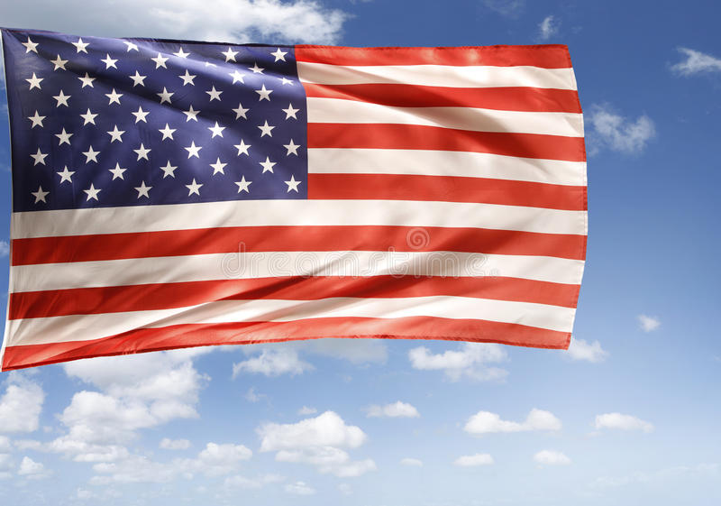 American flag. In front of sky stock photo