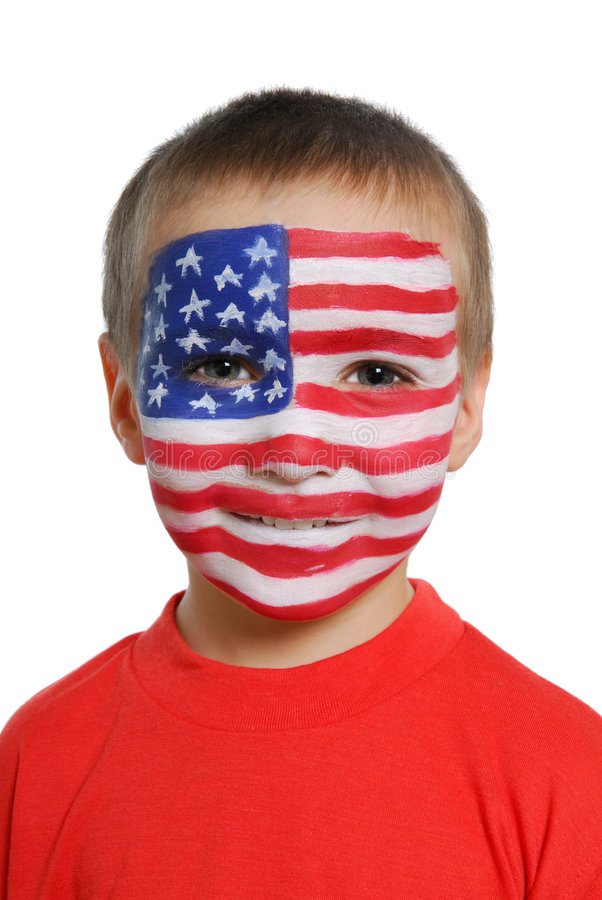 American flag. Portrait of a boy with the American flag painted on his face royalty free stock photography