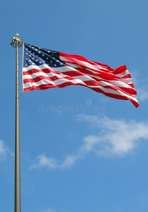 American Flag. On pole against a blue sky background royalty free stock photo