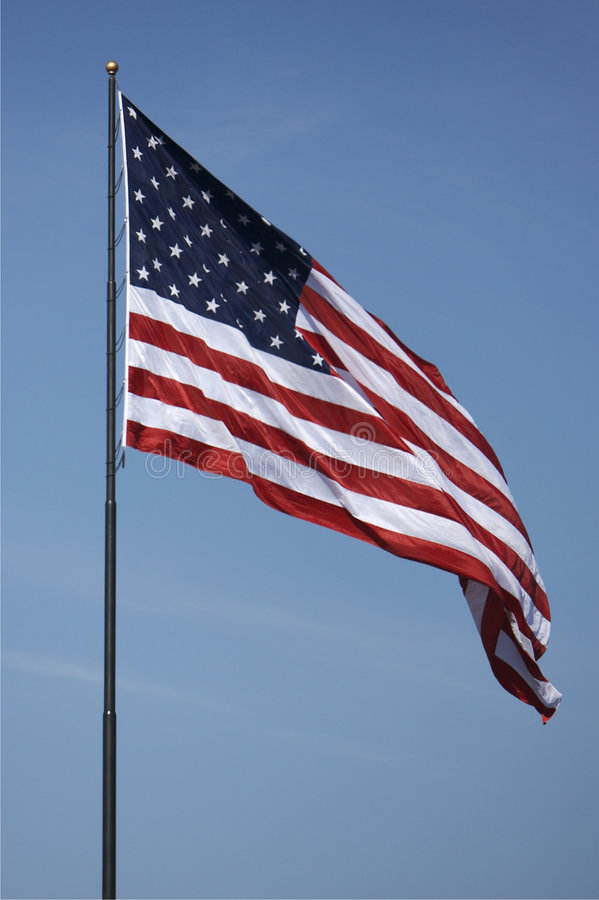 American Flag. US Flag with Blue Sky stock photography