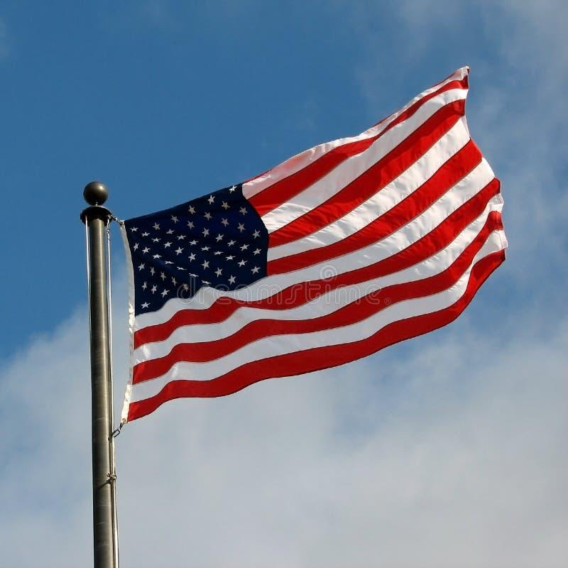 American Flag. Against a blue sky stock photos