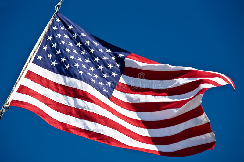 American flag. A shot of an american flag against the blue sky stock images