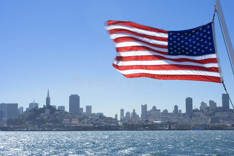 American Flag. The American flag in front of the city San Francisco royalty free stock image