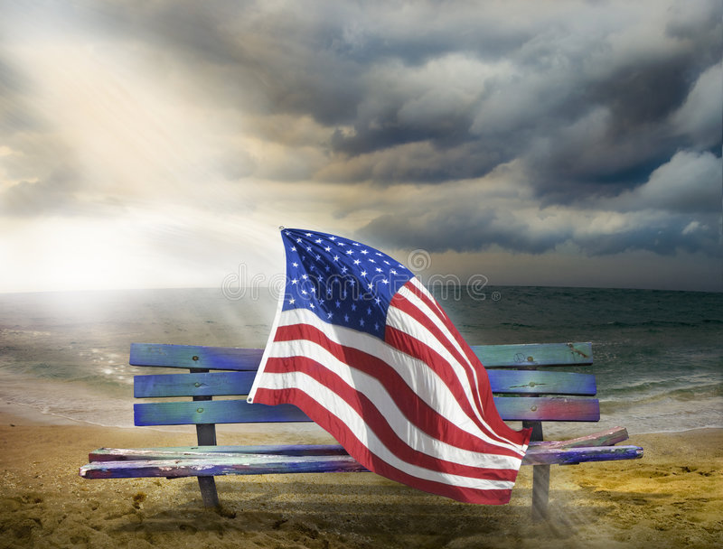 American Flag between darkness and light stock images