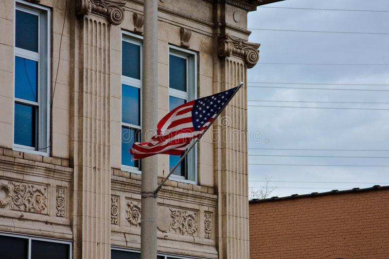 American Flag. Side of a building, with an American flag, in Elizabeth, NJ stock image