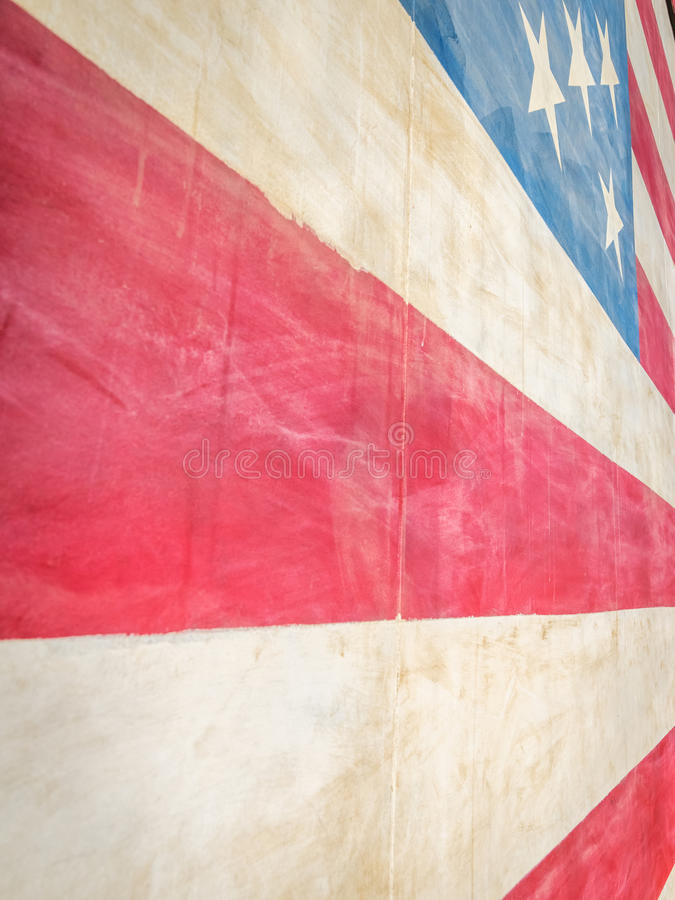 American Flag Abstract I. Extreme close-up of stars and red and white stripes of one story tall painted American flag on wall. Forced perspective stock photos