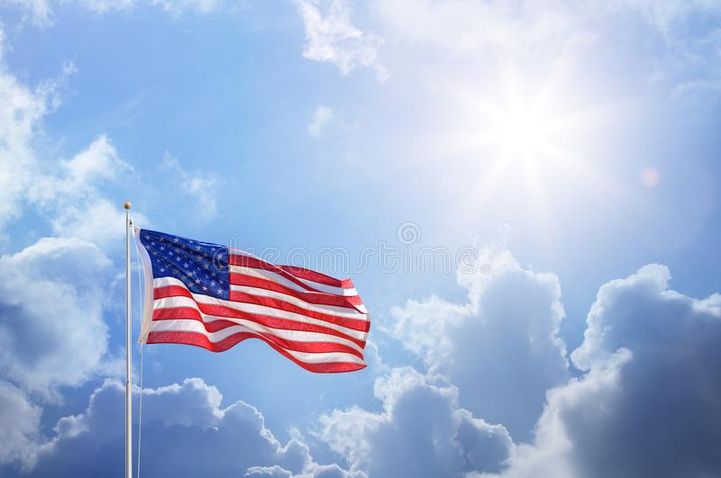American Flag Against Blue Sky stock photography