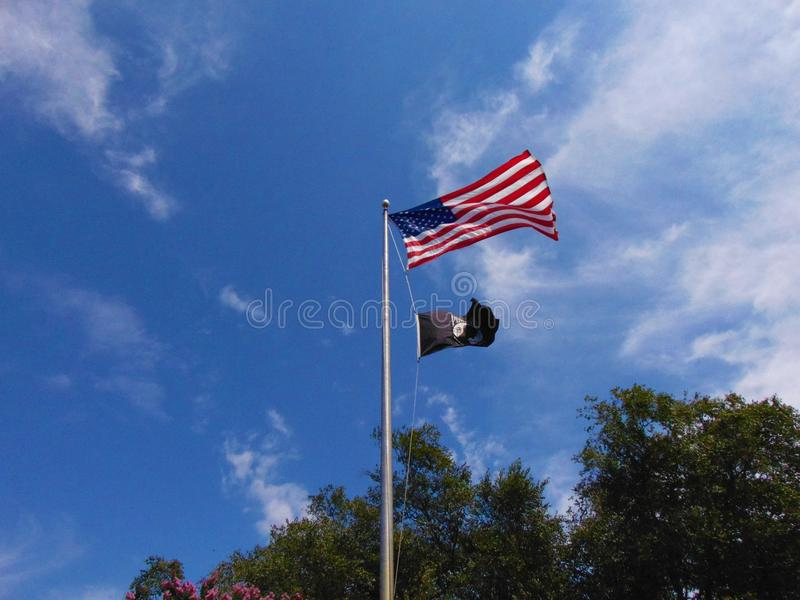 American Flag. Against a bright blue sky with white clouds; Mays Landing, New Jersey stock image